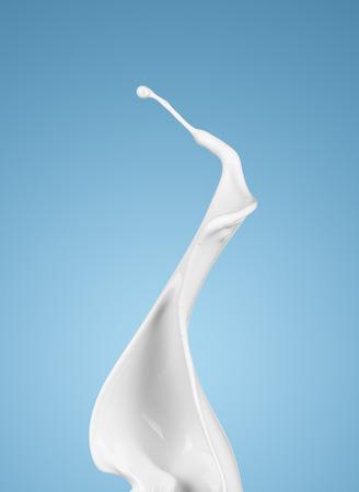 milk or white liquid splash on blue background. isolated Standard-Bild
