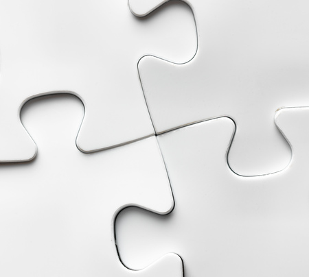 Hand with missing jigsaw puzzle piece. Business concept image for completing the final puzzle piece. Stockfoto
