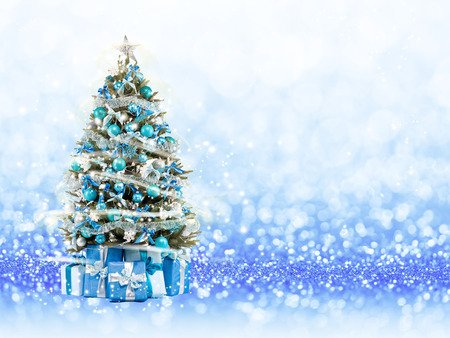 Christmas tree from the xmas lights play with the light. Blue bokeh background Standard-Bild