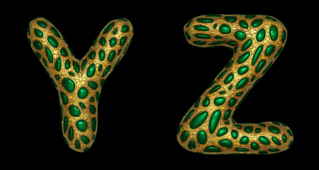 Letter set Y, Z made of realistic 3d render golden shining metallic. Collection of gold shining metallic with green color glass symbol isolated on black background