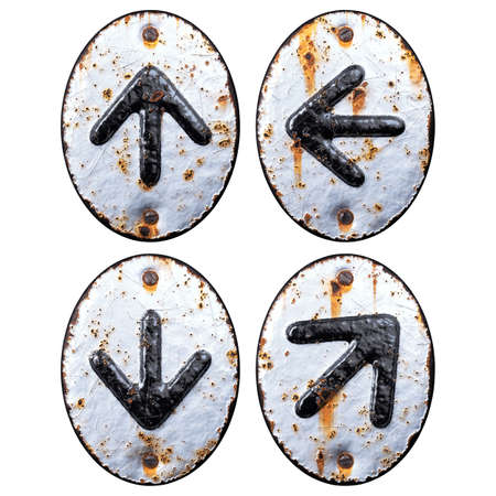 Set of symbols up arrow, right and left arrow, arrow to down made of forged metal on the background fragment of a metal surface with cracked rust.