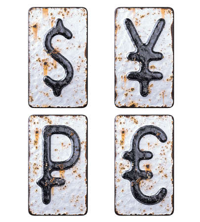 Set of symbols dollar, yen, rouble, euro made of forged metal on the background fragment of a metal surface with cracked rust.