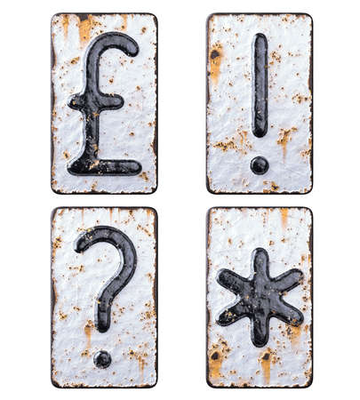 Set of symbols pound, exclamation point, question mark, asterisk made of forged metal on the background fragment of a metal surface with cracked rust.
