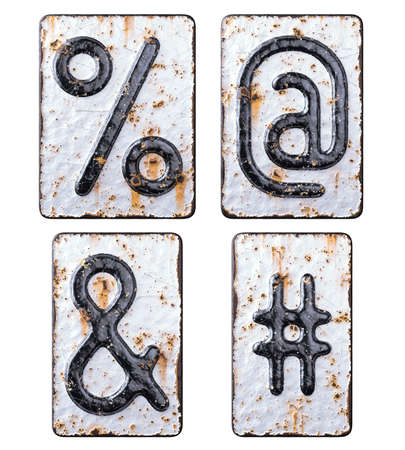 Set of symbols percent, at, ampersand and hash made of forged metal on the background fragment of a metal surface with cracked rust.
