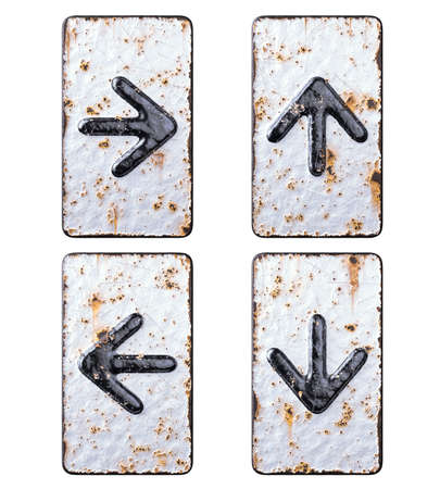 Set of symbols right arrow, up arrow, left arrow and arrow to down made of forged metal on the background fragment of a metal surface with cracked rust.