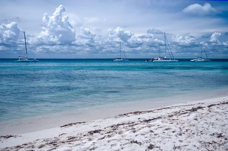 Beach, ocean coast, in the distance the ships, sailing vessels photo