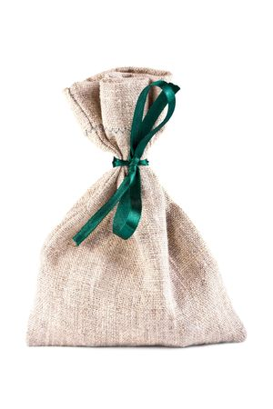 fastened: The linen bag fastened green flight on a white background