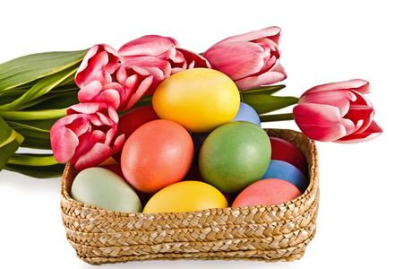 Basket with eggs and flowers, on a white background photo