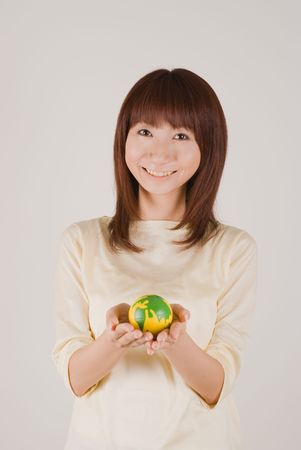 Young woman holding earth ball Stock Photo - 3900194