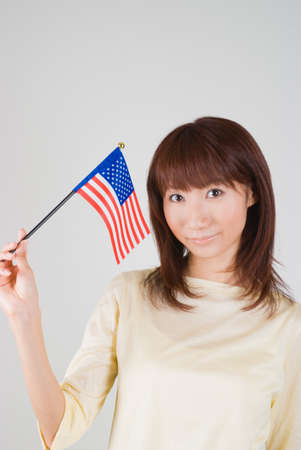 Young woman holding American Flag photo