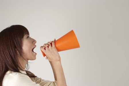 Young woman cheering with megaphone photo