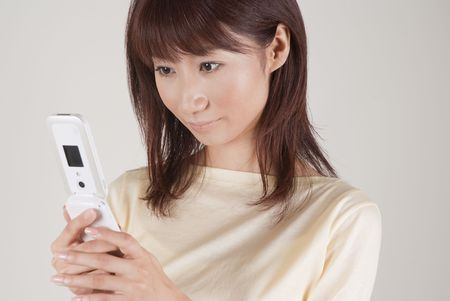 Young woman looking at mobile phone Stock Photo - 6347919