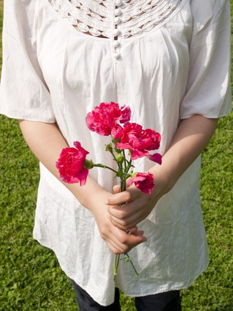 Young woman holding carnation flower photo