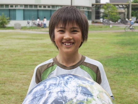 Boy holding globe photo