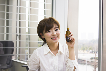 energy drink: Young woman holding energy drink