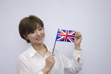 britan: Young woman holding British flag