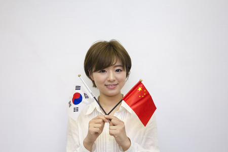 korean flag: Young woman holding Korean flag and Chinese flag