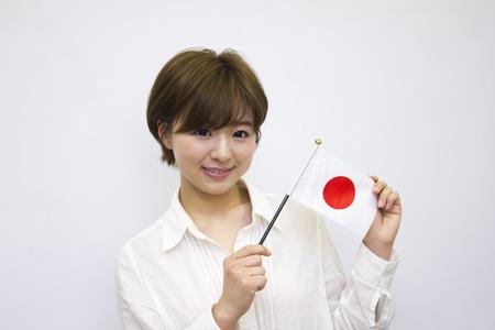 bandera japon: Joven celebración del pabellón japonés