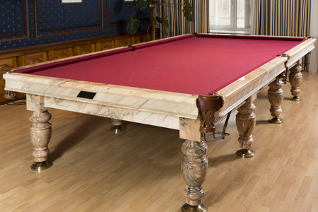 snooker rooms: Luxurious marble table with a red cloth for billiard