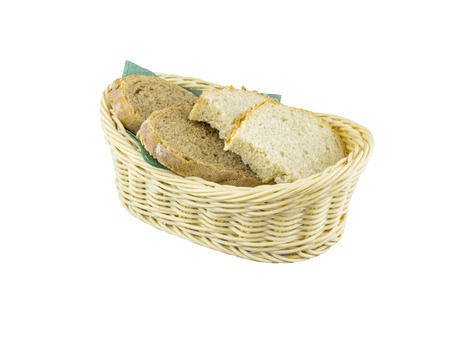 crusty french bread: Fresh bread in wicker basket on an isolated background