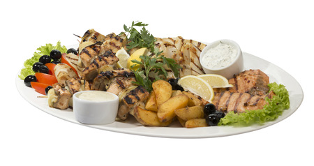 Large dish with seafood on the grill on  an isolated background photo
