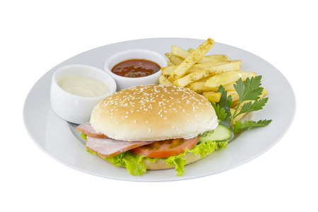 mustard seed: The great hamburger with potato and sauce on an isolated background Stock Photo