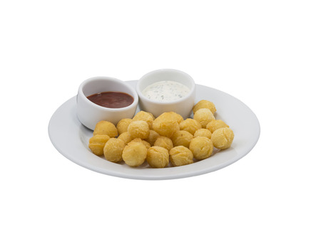 Potato balls with sauce on a dish with isolated background photo