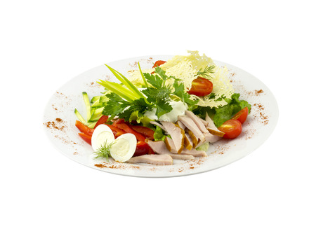 Salad with meat, vegetables and quail eggs on an isolated background photo