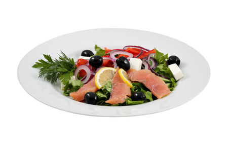 Salmon salad, olives, cheeses and vegetables on an isolated background photo