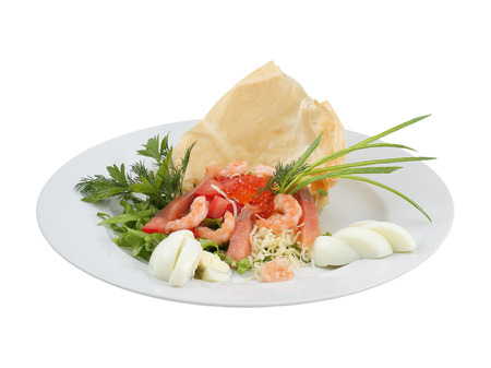 Salmon salad, shrimp and red caviar on an isolated background photo