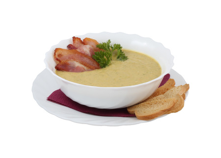 aftertaste: Cream soup with bacon and croutons on an isolated background Stock Photo