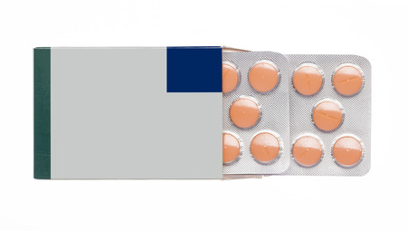 Grey box with orange pills blister pack on an isolated background photo