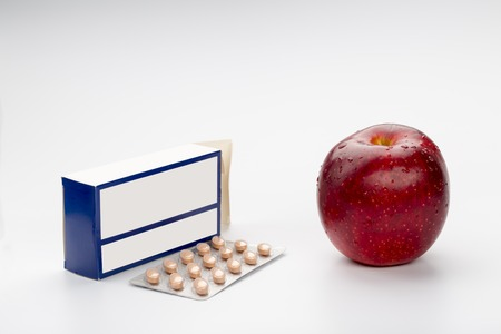 pill box: Pill box and red apple on white background Stock Photo