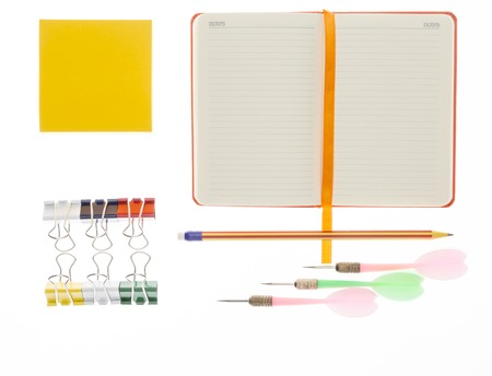 post secondary schools: Notebook, pencil,paper clips and darts on white background