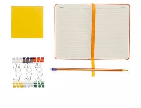 post secondary schools: Pencil,notebook and paper clips on white background