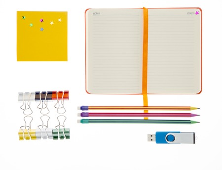 post secondary schools: Notebook, pencil  and memory flash on white background Stock Photo