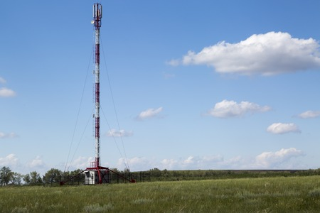 gsm: LTE and GSM tower in sunny summer day Stock Photo
