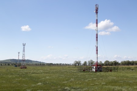 gsm: Telecommunication lte and gsm towers in sunny summer day