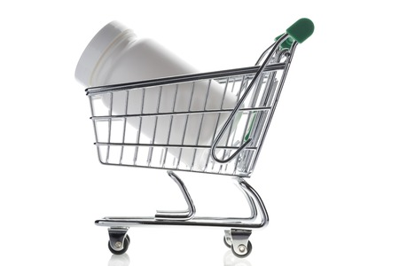 shopping cart isolated: Pill bottle in shopping cart isolated on white. Concept. online store pharmacy Stock Photo