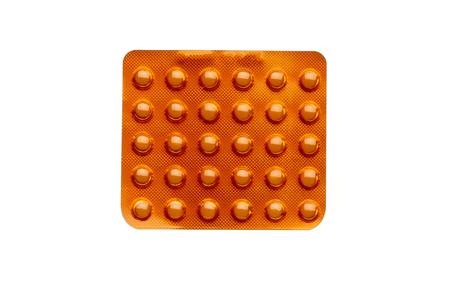 bolus: Orange pills in a blister pack on white background