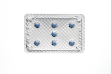 blister package: Blue pills in blister package isolated on white background.Above view