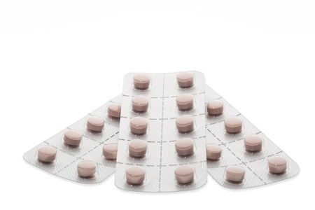 blister package: Set of pills in a blister package on white background