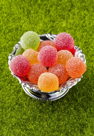 sweet treat: Colorful fruit jelly candies. Close-up.On the background of green grass Stock Photo