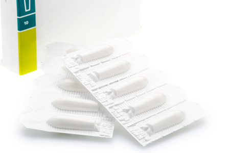 suppositories: Vaginal suppository in plastic strip pack on white background