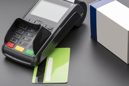 pill box: POS terminal, credit card and pill box on black background Stock Photo