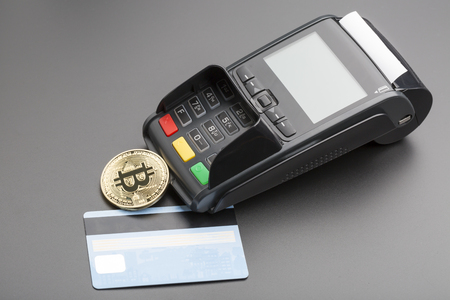 Bitcoin,POS-terminal and credit card.business concept over black Stock Photo
