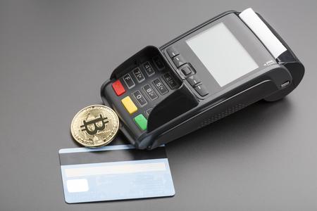 conputer: Bitcoin,POS-terminal and credit card.business concept over black Stock Photo