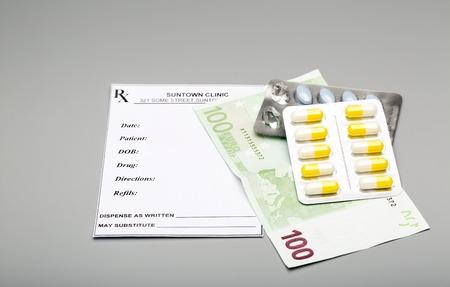 one hundred euro banknote: Blank prescription,blister pack of pills and one hundred euro banknote