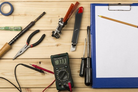 electric tools: set-up of various hand and electric tools on a wooden table