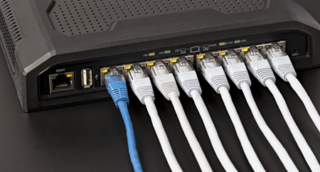Managed switch with 10 power over ethernet gigabit ports on black background 스톡 콘텐츠